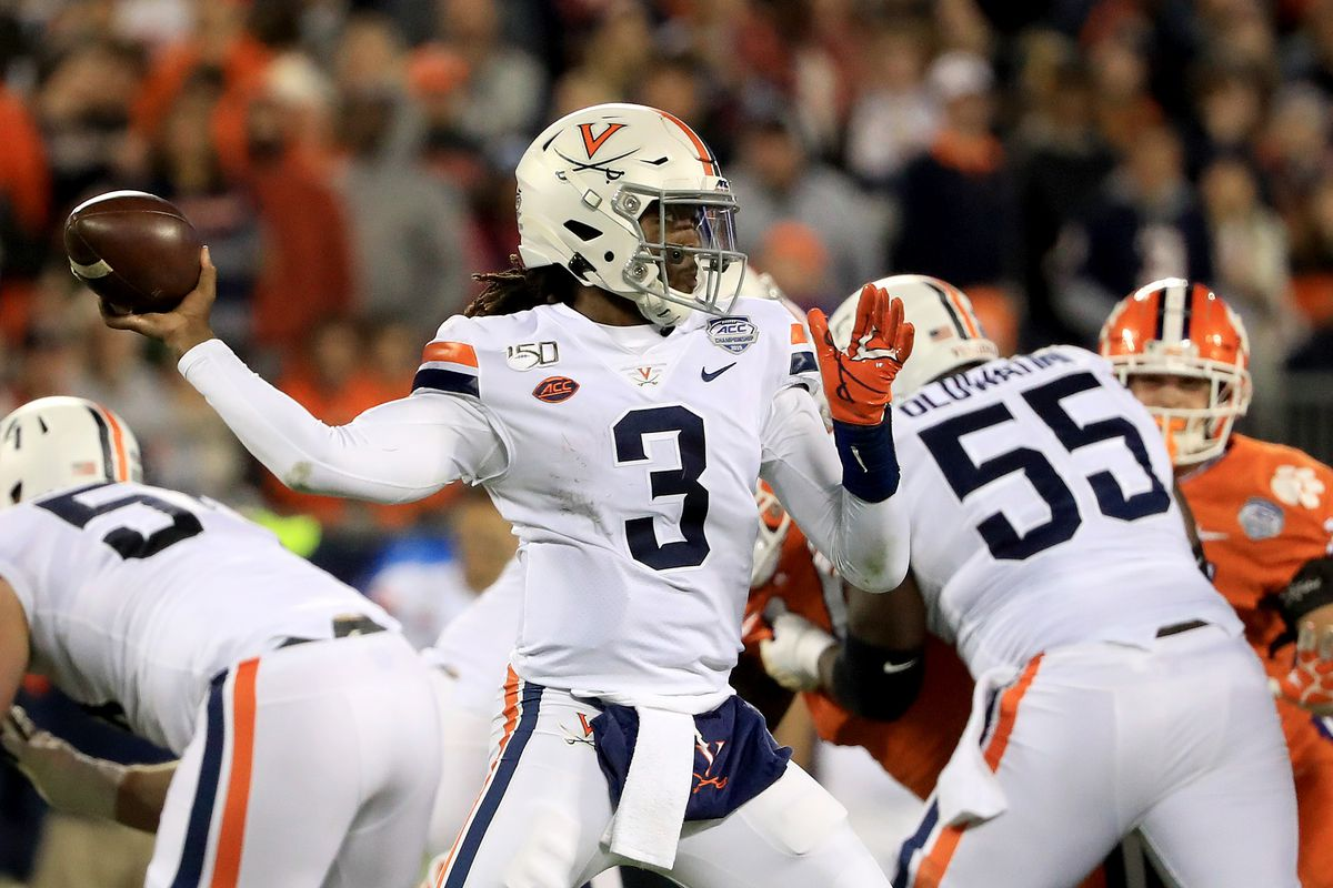 Bryce Perkins of the Virginia Cavaliers drops back to pass against the Clemson Tigers during the ACC Football Championship game at Bank of America Stadium on December 07, 2019 in Charlotte, North Carolina.