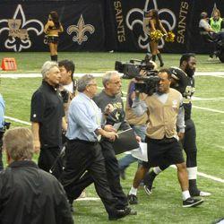 Greg Bensel chats with Joe Vitt walking off the field.