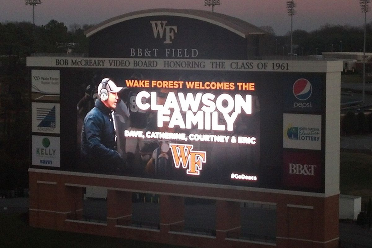 The video board at BB&T Field welcomes new head coach Dave Clawson and family