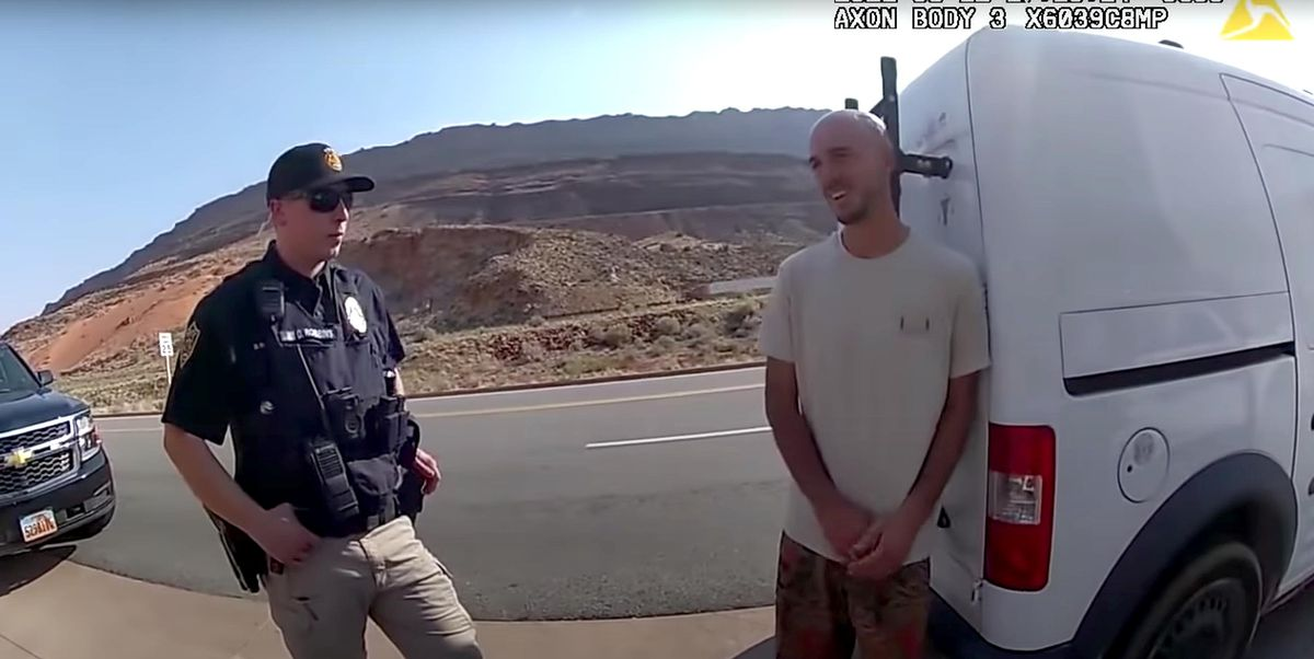 """Newly released police body camera video provided by the Moab Police Department shows Brian Laundrie, right, talking to a police officer on Aug. 12, 2021. Police pulled over the van he was traveling in with his girlfriend, Gabrielle """"Gabby"""" Petito, near the entrance to Arches National Park."""