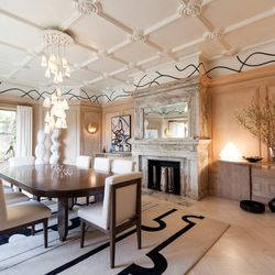 """<a href=""""http://heatherhilliard.com/"""">Heather Hilliard Design's</a> philosophy for the dining room was """"classic detailing with the restraint of modern design."""" The wood panel walls and ceiling pattern are permanent, so Heather introduced """"custom minimal f"""