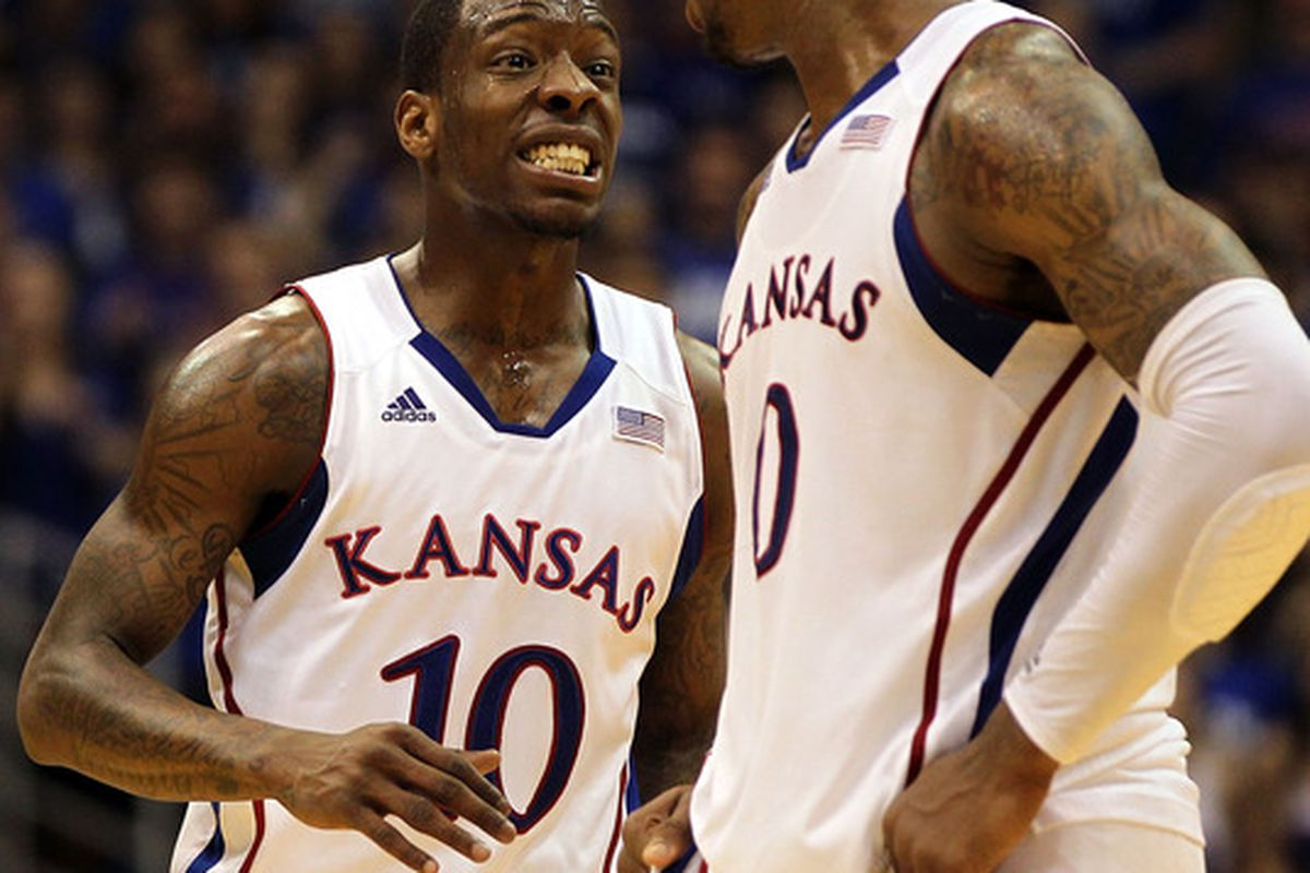 LAWRENCE, KS - FEBRUARY 25:  Tyshawn Taylor #10 the Jayhawks reacts with Thomas Robinson #0 as the game against the Missouri Tigers goes into overtime on February 25, 2012 at Allen Fieldhouse in Lawrence, Kansas.  (Photo by Jamie Squire/Getty Images)