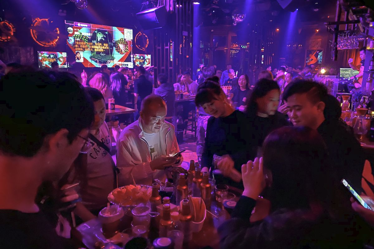 Residents enjoy night life at a club in Wuhan in central China's Hubei province on Sunday, Oct. 18, 2020.