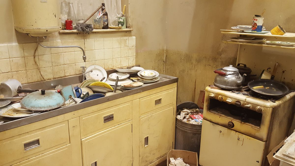 """The Rolling Stones' first London flat, including the kitchen sink that Mick Jagger jokingly said contains """"too many dirty dishes,"""" has been recreated for """"Exhibitionism.""""   MIRIAM DI NUNZIO PHOTO"""