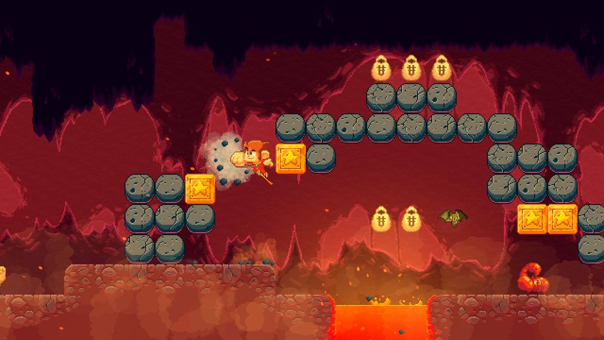 Alex Kidd punches a block in a lava level from Alex Kidd in Miracle World DX