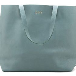 """<strong>Cuyana</strong> Leather Tote, <a href=""""http://www.cuyana.com/leather-tote-blue.html"""">$150</a> (monogramming an additional $10)"""