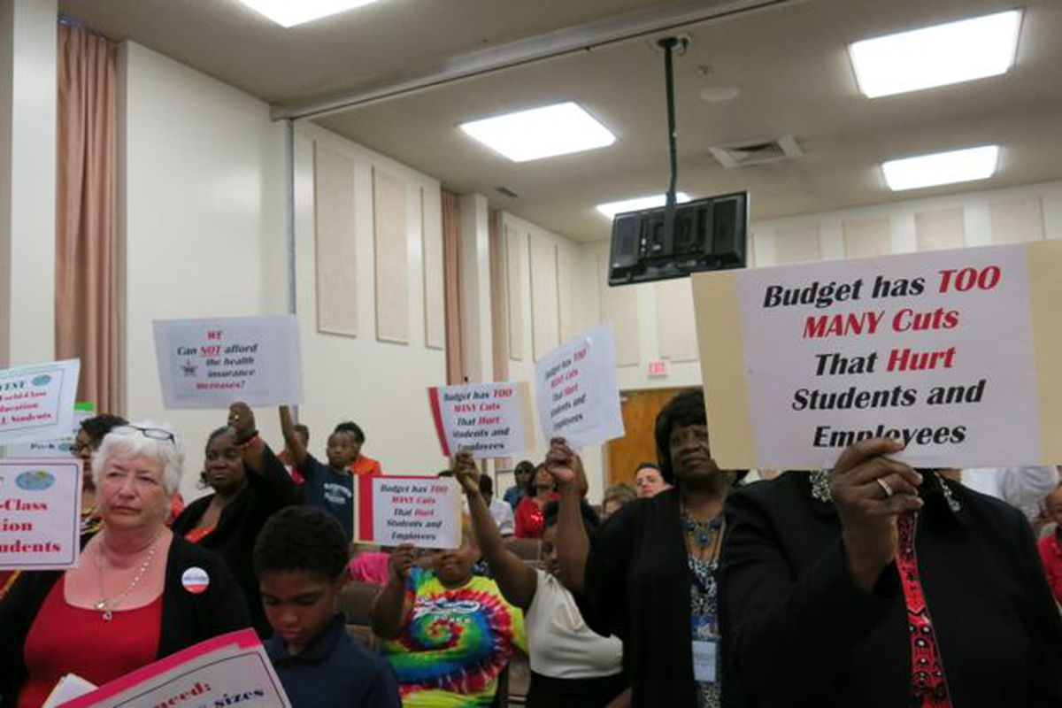 Several Shelby County School teachers protested budget cuts during Tuesday's called meeting to approve the 2014-15 budget.