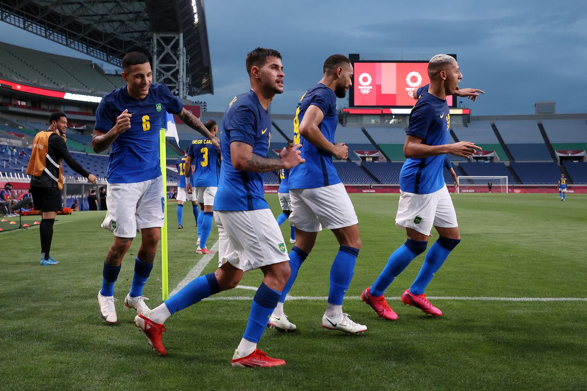 Richarlison #10 of Team Brazil celebrates with team mates after scoring their side's second goal during the Men's First Round Group D match between Saudi Arabia and Brazil on day five of the Tokyo 2020 Olympic Games at Saitama Stadium on July 28, 2021 in Saitama, Japan.