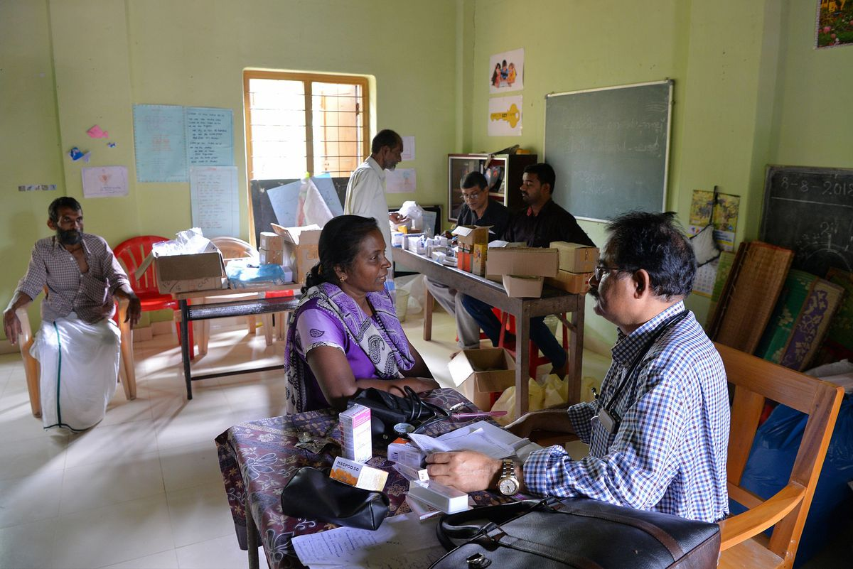 A doctor checks a patient at a medical center in a flood-relief camp in Kozhikode, about 385 km north of Trivandrum, on August 17.