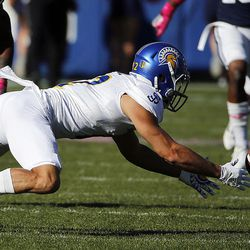 San Jose State Spartans cornerback Brandon Ezell fumbles the ball and Brigham Young Cougars defensive back Zayne Anderson recovers during NCAA football in Provo on Saturday, Oct. 28, 2017.