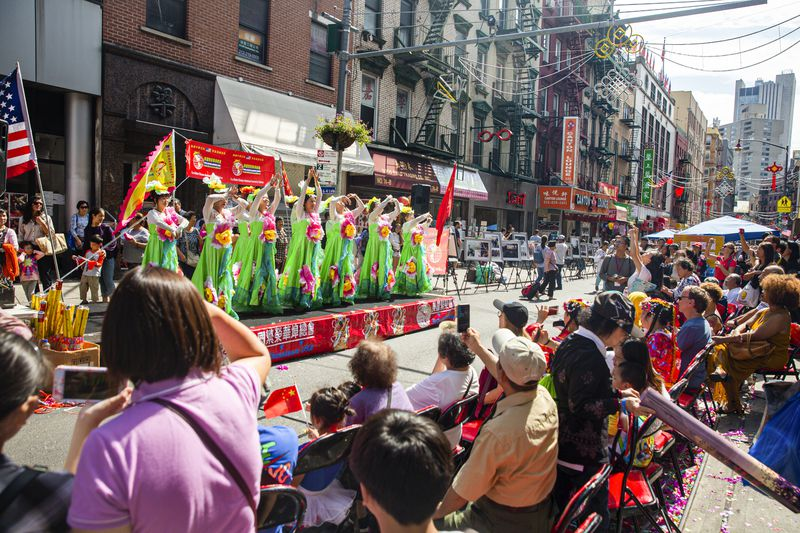 Chinese dancers perform on a float in a parade on Mott Street in New York City's Chinatown.