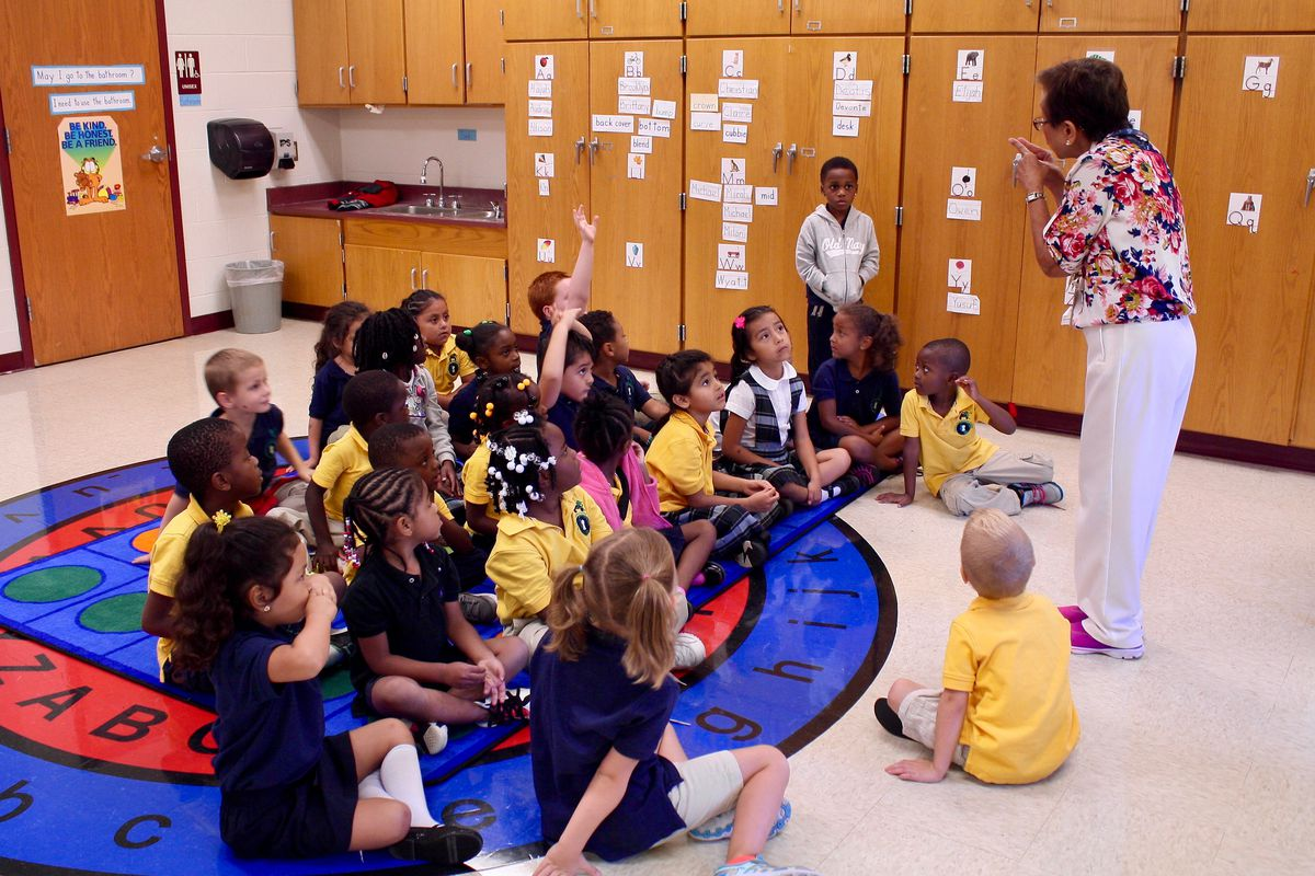 A kindergarten class at Global Prep Academy's dual language program gather for a lesson in sorting.