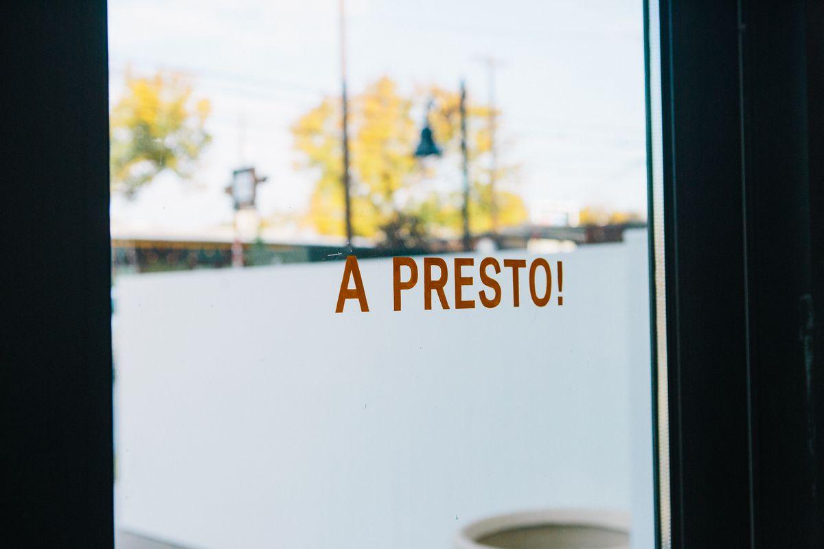 """The door says """"see you soon"""" in Italian"""