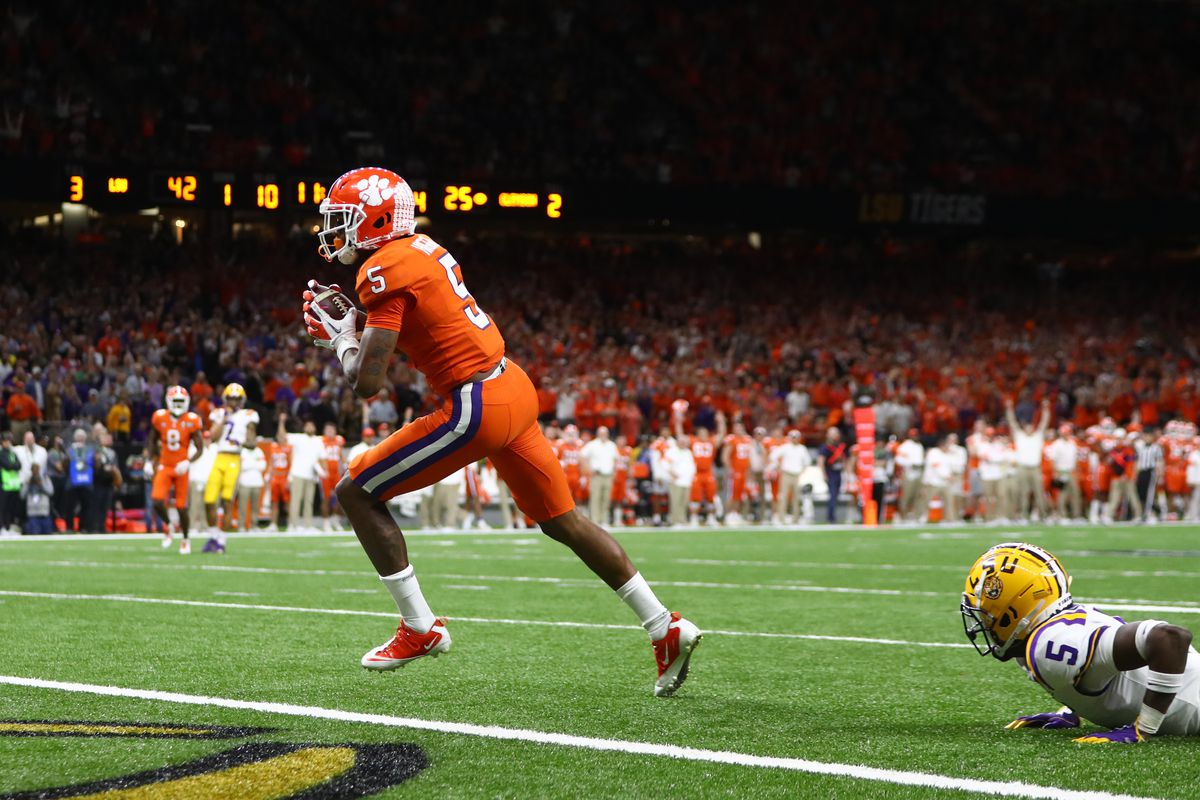 Clemson Tigers wide receiver Tee Higgins scores a touchdown in the College Football Playoff national championship game against the LSU Tigers at Mercedes-Benz Superdome.