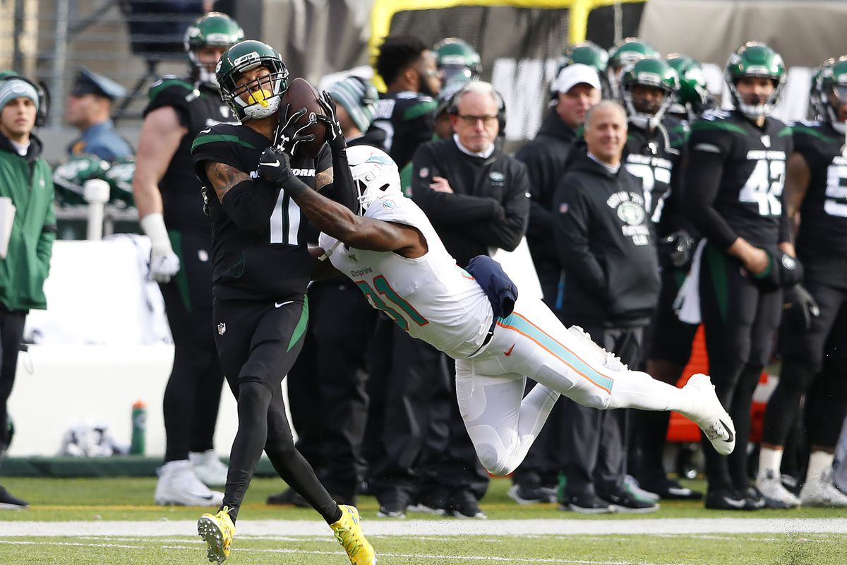New York Jets wide receiver Robby Anderson makes a catch against Miami Dolphins defensive back Ken Webster during the first half at MetLife Stadium