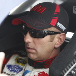 Greg Biffle sits in his car before practice for the NACAR Sprint Cup Series auto race at Texas Motor Speedway on Thursday, April 12, 2012, in Fort Worth, Texas.