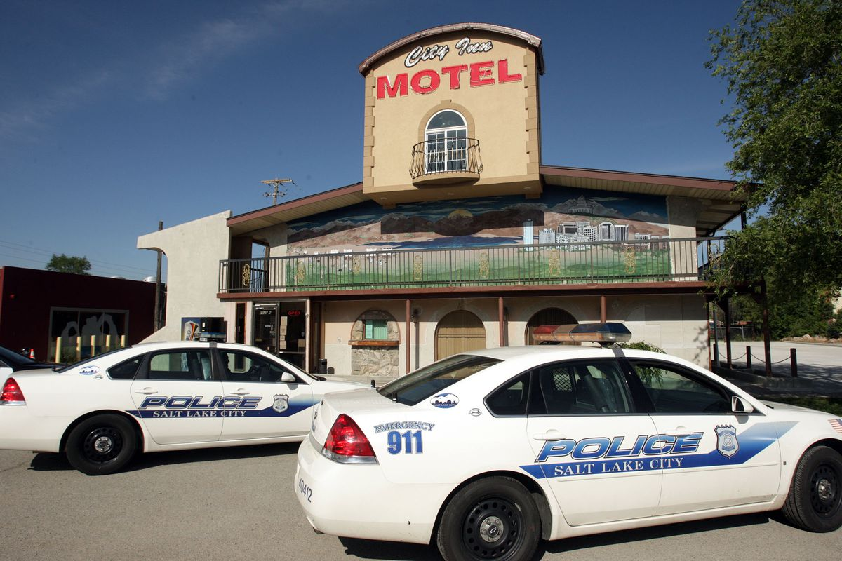 Salt Lake police investigate a stabbing at the Salt City Inn motel in Salt Lake City on May 30, 2012.