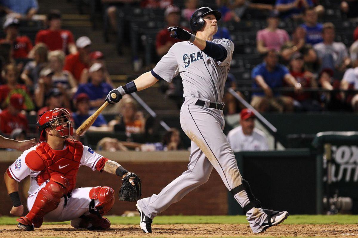 Arlington, TX, USA; Seattle Mariners first baseman Justin Smoak (17) hits a three run home run during the eighth inning against the Texas Rangers at Rangers Ballpark.  Mandatory Credit: Kevin Jairaj-US PRESSWIRE