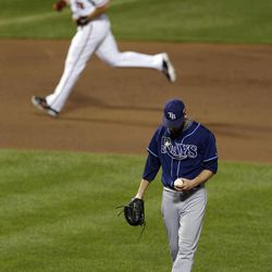 Tampa Bay Rays relief pitcher J.P. Howell, bottom, stands on the mound as Baltimore Orioles' Chris Davis rounds the bases after hitting a solo home run in the seventh inning of a baseball game in Baltimore, Tuesday, Sept. 11, 2012.