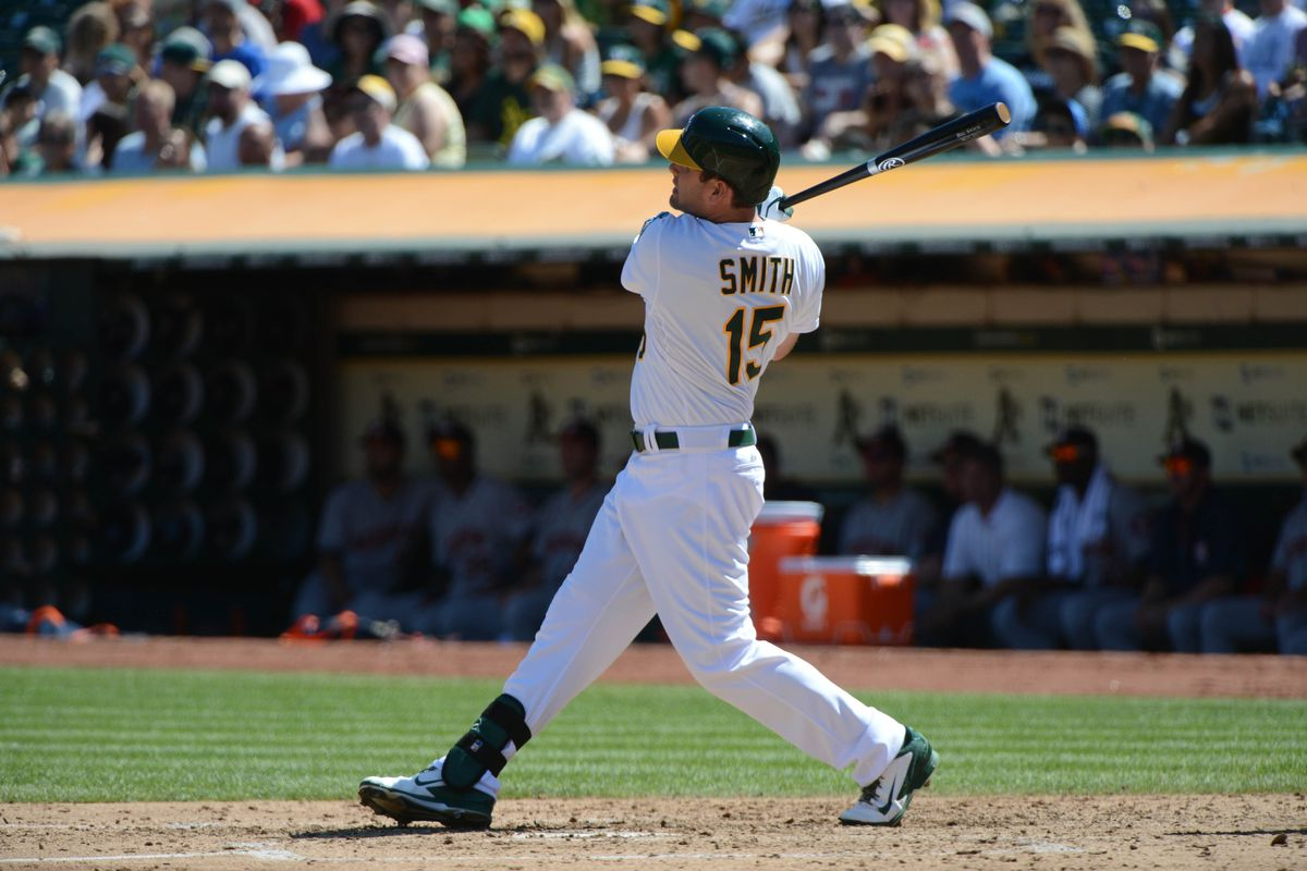 Seth Smith's three-run bomb the right field in the third inning broke the game open for the A's.