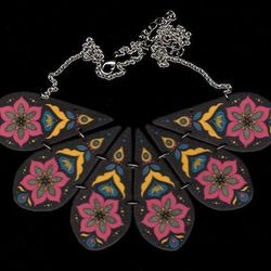 """""""The <a href=""""http://birdqueendesigns.com/artwork/2937403_Fuchsia_Folk_Flower_Bib_Necklace.html"""">Folk Flower Bib Necklace</a> ($50) was inspired by the folk art and bold colors from Pennsylvania Dutch hex signs. Keep an eye out for more necklace and earri"""