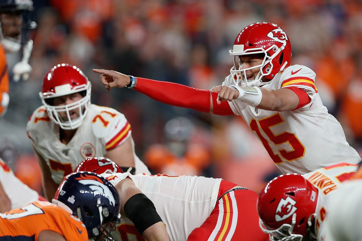 Quarterback Patrick Mahomes of the Kansas City Chiefs directs his team from the line of scrimmage against the defense of the Denver Broncos in the game at Broncos Stadium at Mile High on October 17, 2019 in Denver, Colorado.