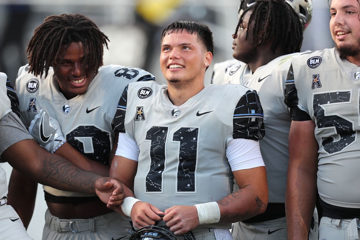 Quarterback Dillon Gabriel of the Central Florida Knights celebrates with teammates after the win against the Tulane Green Wave at Bounce House-FBC Mortgage Field on October 24, 2020 in Orlando, Florida.