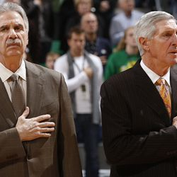 Assistant Jazz coach Phil Johnson and head coach Jerry Sloan show respect during the national anthem prior to the start of the Utah Jazz game against the Memphis Grizzlies in the EnergySolutions Arena in Salt Lake City Nov. 30, 2009.