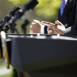 The hands of President Barack Obama, Mexican President Felipe Calderon, left, and Canadian Prime Minister Stephen Harper rest on a podium during a news conference on illegal drugs Monday in Washington.