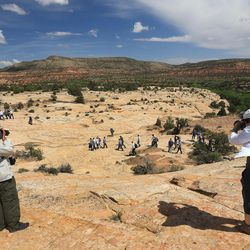 Interior Secretary Ryan Zinke and others leave an overlook in the Butler Wash area of the Bears Ears National Monument after viewing ancient ruins on Monday, May 8, 2017.
