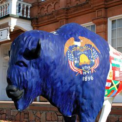 """A beehive bison. What better way is there to underline the folkloric longevity of the Deseret beehive than a fiberglass bison statue decorated with elements of Utah's state flag (and other flags, as well), complete with a beehive and the motto """"Industry,"""" standing outside the Utah Travel Council offices on Capitol Hill?"""