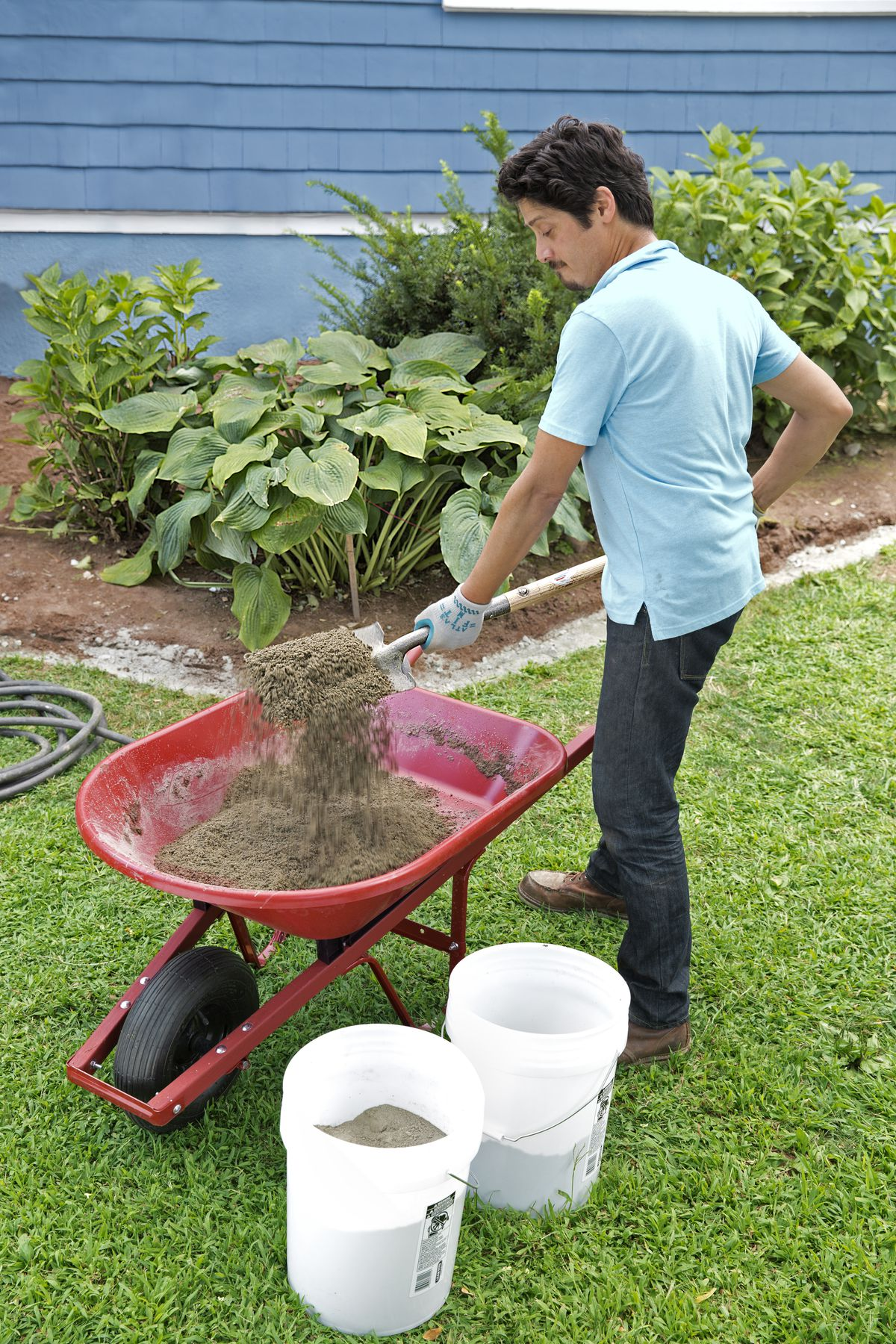 Man Mixes Stone Dust And Portland Cement