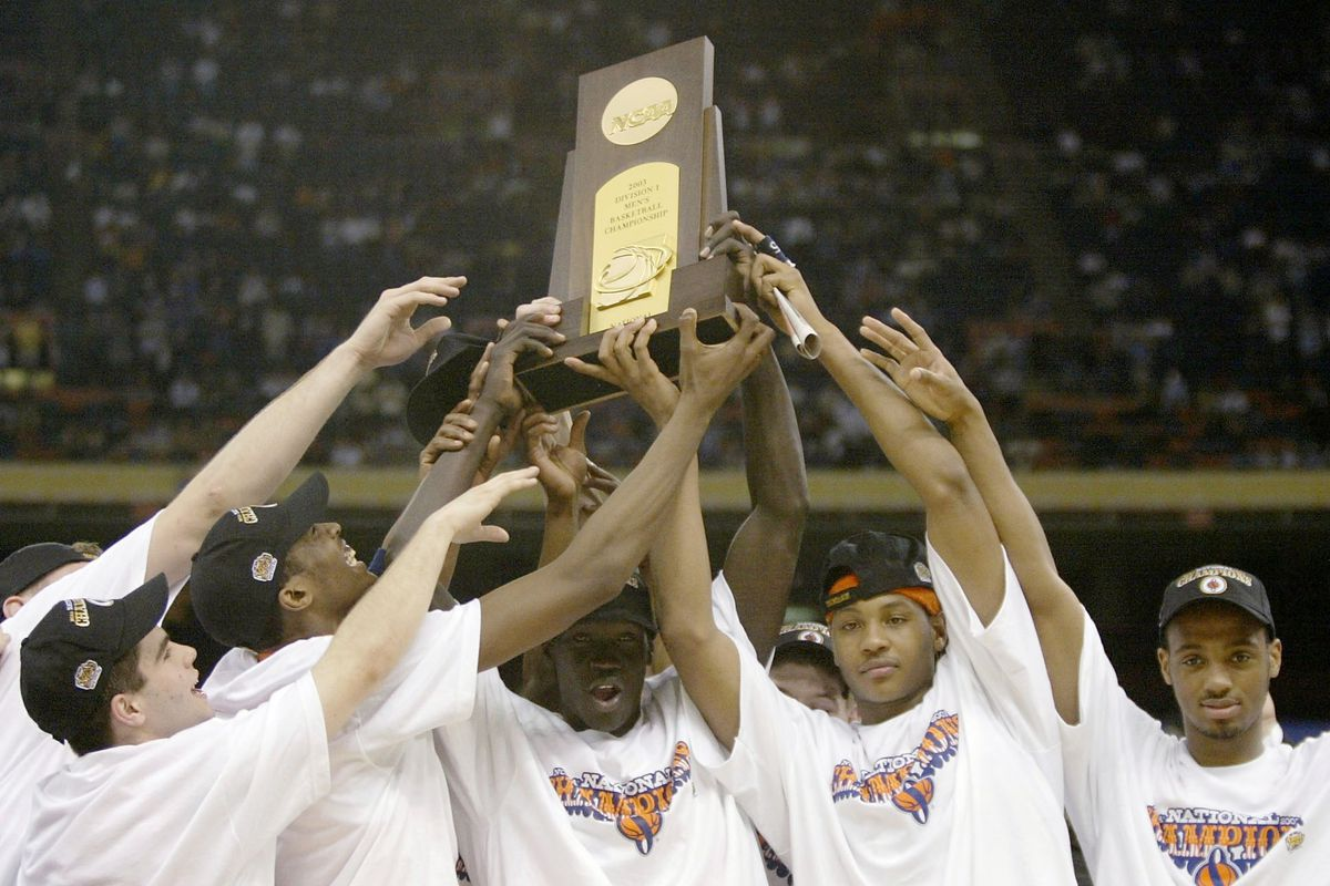 Syracuse celebrates with the trophy