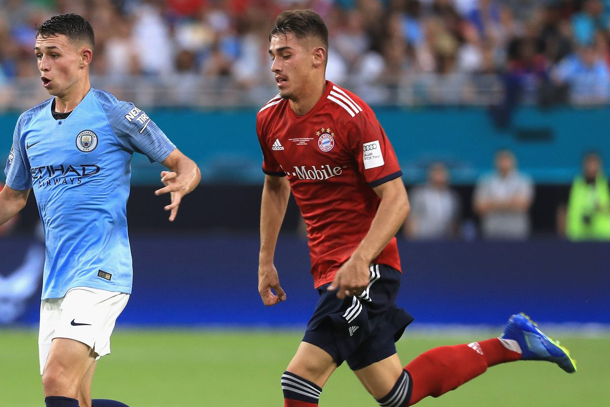 FC Bayern Munich v Manchester City - International Champions Cup 2018 MIAMI, FL - JULY 28: Aymeric Laporte #14 of Manchester City is chased by Meritan Shabani #47 of FC Bayern Munich during the first half of the International Champions Cup 2018 match at Hard Rock Stadium on July 28, 2018 in Miami, Florida.