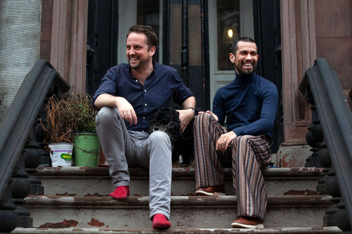 David Montalvo shares a moment of levity with husband James Robinson and pet Compass on their Fort Greene, Brooklyn stoop.