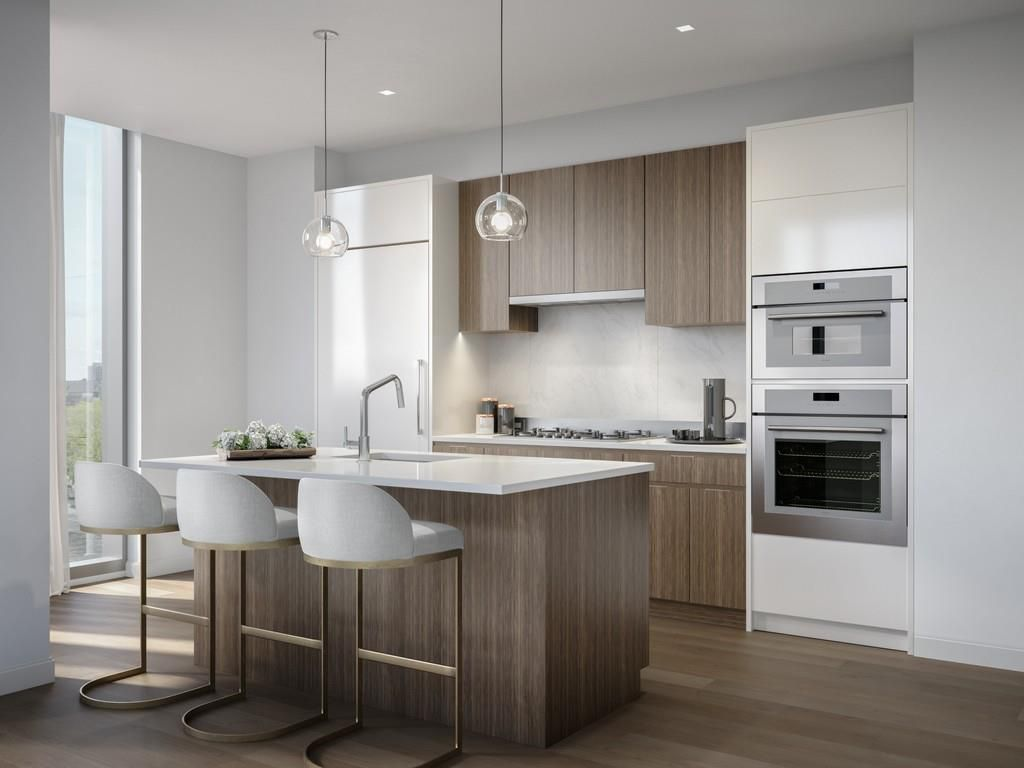 Rendering of a sleek kitchen in a new condo.