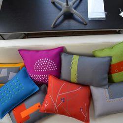 "Pillows at Skynear Designs [Image: Skynear Designs/<a href=""https://www.facebook.com/photo.php?fbid=575061462555684&set=pb.349337781794721.-2207520000.1392376967.&type=3&theater"">Facebook</a>]"
