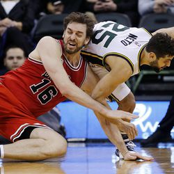 Chicago Bulls center Pau Gasol (16) and Utah Jazz guard Raul Neto (25) reach for a loose ball during NBA basketball in Salt Lake City, Monday, Feb. 1, 2016.