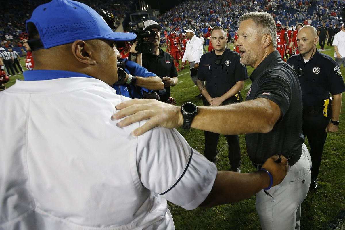 Utah Utes head coach Kyle Whittingham and BYU Cougars head coach Kalani Sitake greet after the game in Provo.