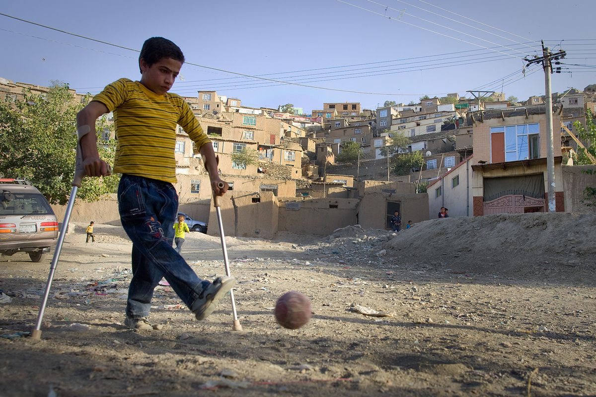 An 11-year-old with polio plays soccer in Kabul, Afghanistan in 2009.