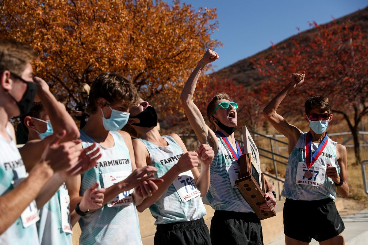 Farmington runners celebrate their team victory in the 5A boys state cross-country championship at Soldier Hollow in Midway on Thursday, Oct. 22, 2020.