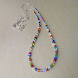 """The Ligne is a long, drapey and soft beaded piece that can be doubled as a choker. This necklace was an """"Editor's Pick"""" in Lucky Magazine.<br />$96"""