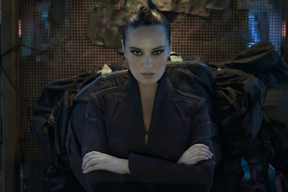 Drummer stars into the camera in a press photo for the season 5 of The Expanse