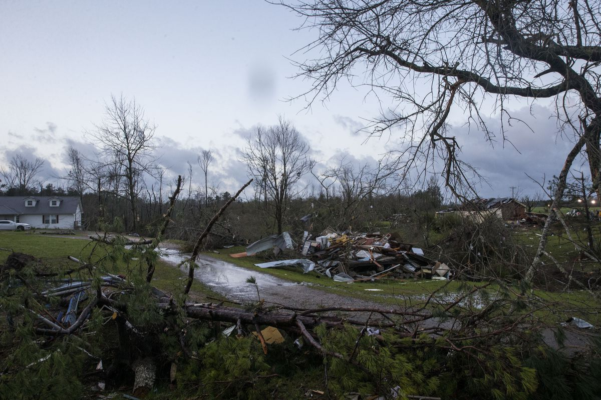 The sun rises over weather-damaged properties in Clanton, Ala., the morning following a large outbreak of severe storms across the southeast, Thursday, March 18, 2021.