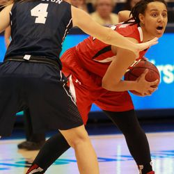 With seconds left on the clock in the second half, Utah's Ciera Dunbar looks to make a pass around BYU's Kim Beeston during a women's basketball game at the Marriott Center in Provo on Saturday, Dec. 14, 2013. Utah won in double overtime 82-74.