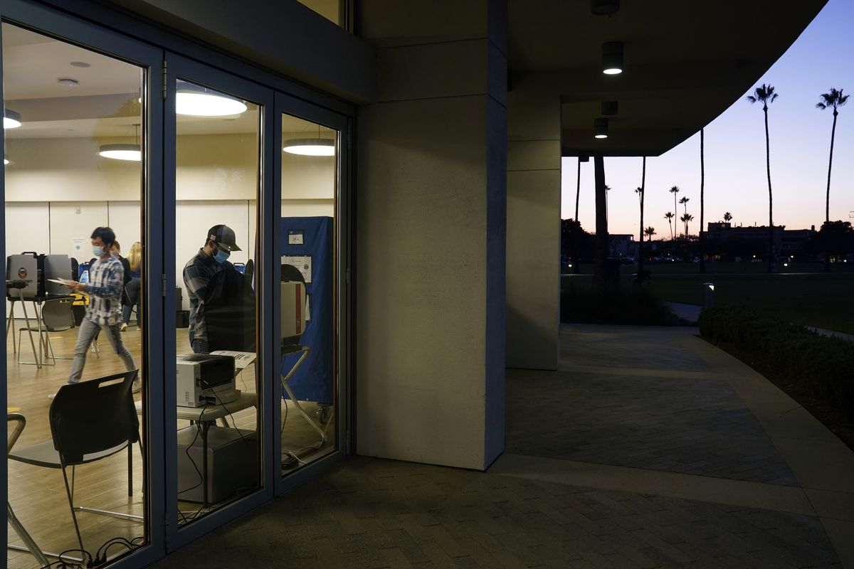 Voters cast their ballots at a polling place in Newport Beach, Calif.