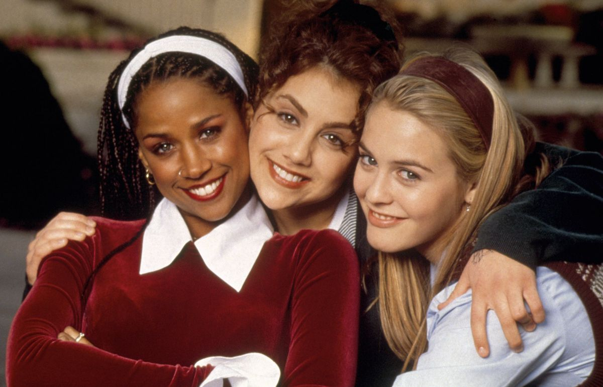 Alicia Silverstone, Stacey Dash, and Brittany Murphy pose in a hug in Clueless.