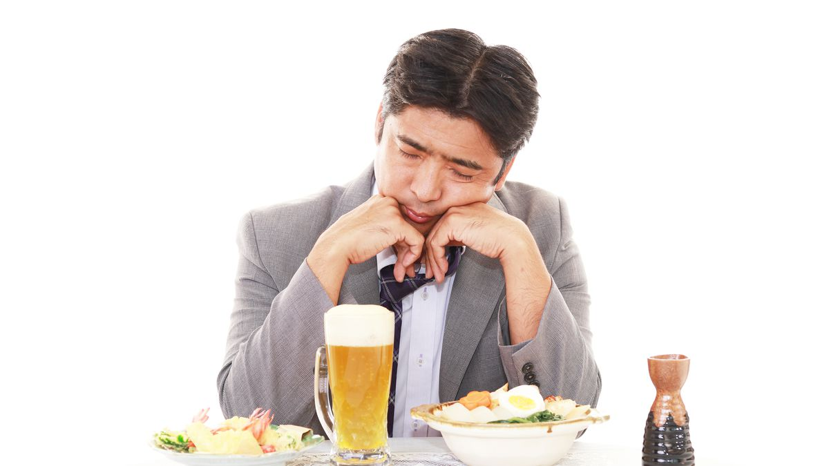 A disappointed man at a restaurant.