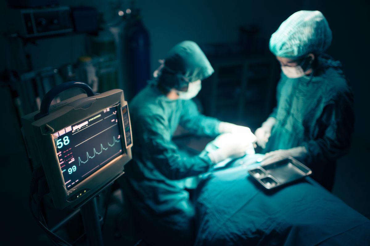 doctors around patient