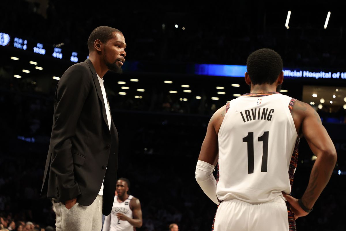 Kevin Durant of the Brooklyn Nets talks to Kyrie Irving of the Brooklyn Nets during their game against the Milwaukee Bucksat Barclays Center on January 18, 2020 in New York City.